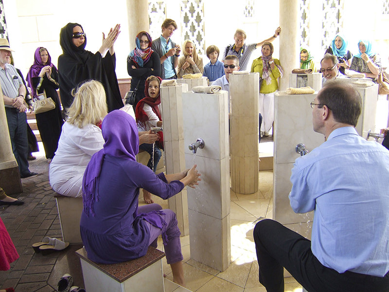 Guide at Dubai mosque demonstrates cleansing ritual--Photo by Wallace Immen