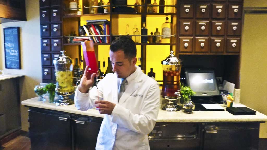Daniel the bartender mixing at the Alchemy Bar on Carnival Sunshine